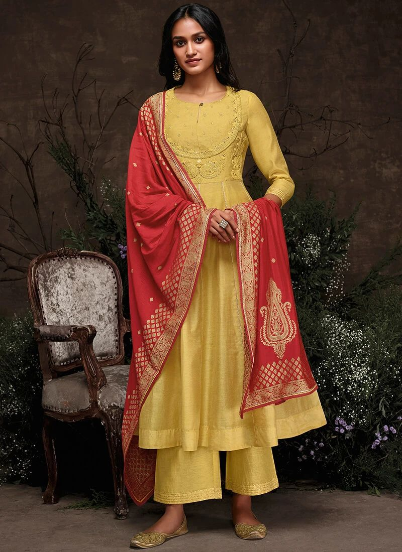 Slim lady wearing a Yellow & Red Anarkali Suit