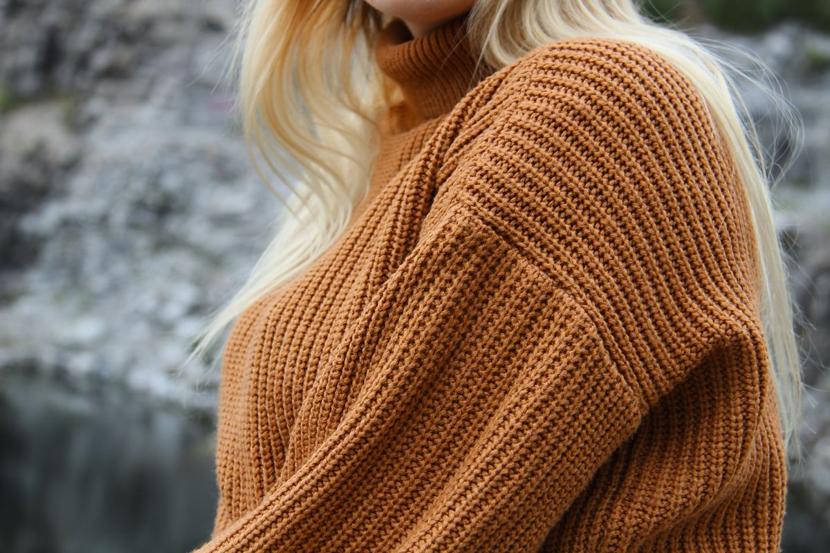 Woman wearing knit sweater