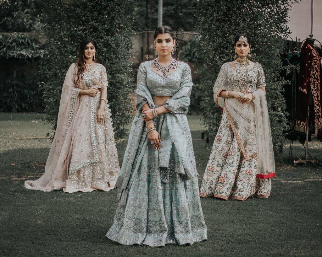 ladies wearing lehengas